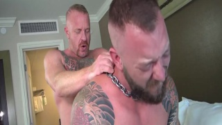 bearded cub with chain around his neck takes daddy's hard cock