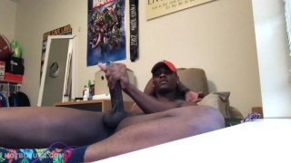 black stud Wearing nothing but a ball cap and socks