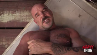 bald daddy Jack Dyer jerks his cock