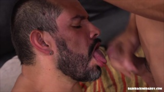 bearded man takes his boy's cum load on his face