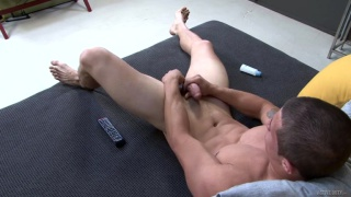 Bradley Hayes strokes his thick cock