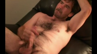 furry man Shannon jacks off in a recliner
