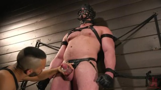Blake Hunter restrained and hooded for edging session