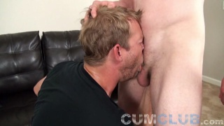 cocksucker deep throats a ginger guy's large cock