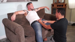 masculine guy in muscle tee and jeans gets a blowjob