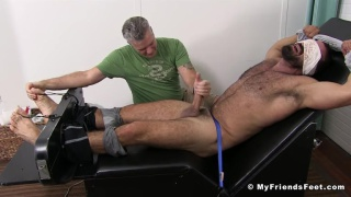 Ricky Larkin strapped into the tickling chair