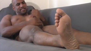 naked hunk shows off his size 13 feet