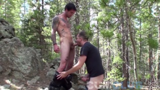 Mountain Man gives a slender straight guy outdoor head