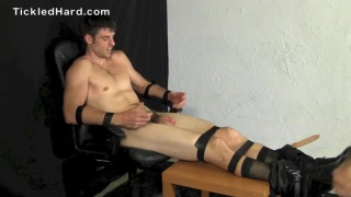 Aiden Tripp strapped into the tickling chair