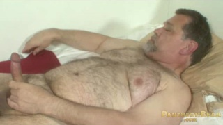 Stroking his Fat Bear Cock