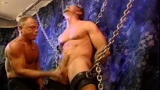 Hot Bound Hunk Gets His Balls Bashed