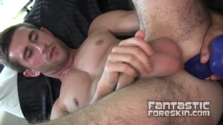 Ethan Roberts work his foreskin with toys