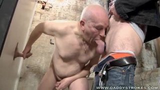 Two Mature Guys Having Fun At The Gloryhole