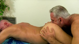Silver Daddy Topping on Massage Table