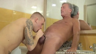 Daddy And Lad Suck And Jerking In The Restroom