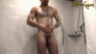 muscular guy showers