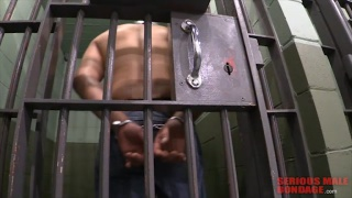 prisoner in jail at serious male bondage