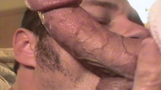 down on his knees sucking on his buddies cock