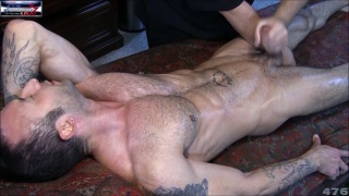 stroking sesso's cock with a dildo up his butt