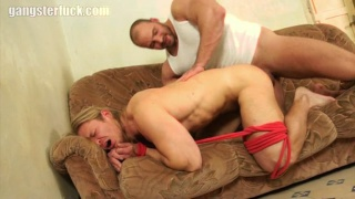 muscled gangster sticks his big cock in captive's ass