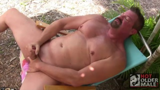 leather daddy jacking his dick outdoors