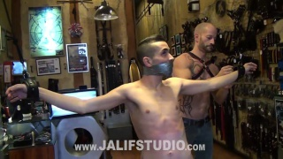 sub gets a beating before worshipping his master's boots