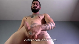 Spanish hipster jacks his big thick uncut cock