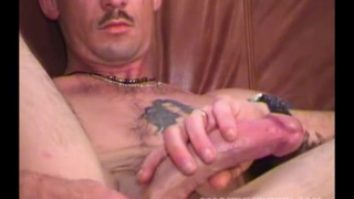 inked guy blows cum on his treasure trail