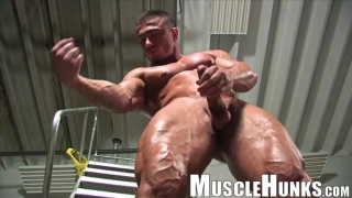 bodybuilder showing off his unusually large cock