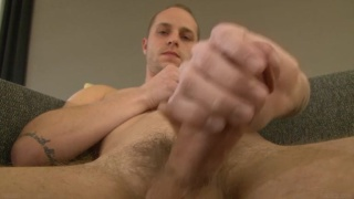 slim dude Toby Nelson strokes his big-nobbed dick