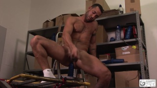playing with a dildo in the store room