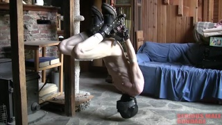 hooded slave shackled upside down