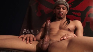 black stud in tuque pulling his huge dick
