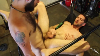 bearded dude fucks his buddy in the garage