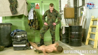 uniformed soldier puts new recruit through naked drills