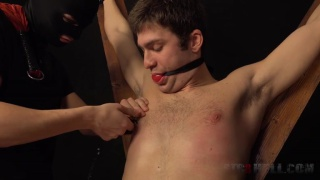 young lad tied to a cross and flogged
