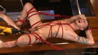 cocky punk trevor spade tied up with red rope