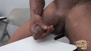 thug bottom strokes his fat uncut cock