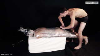 young lad wrapped up in cling-film and fucked