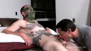 ANGELO wears a mask for his blowjob