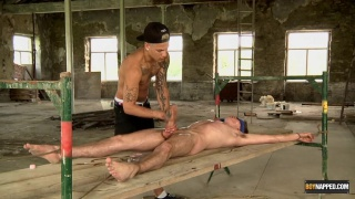 slave boy Johnny spread eagle and blindfolded