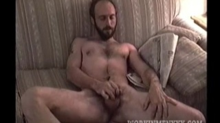 furry bearded redneck unloads in his hand