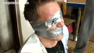pretty blond lad tied up with duct tape