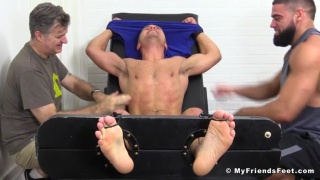 two men tickle tommy's armpits