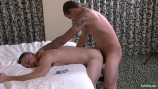 Brad Davis bends johnny over the bed
