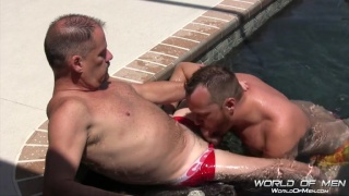 real-life couple of daddies have pool sex