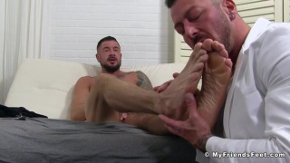 hugh hunter massages Dolf Dietrich's tingling feet