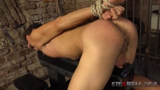 sexy guy gets spanking in the dungeon