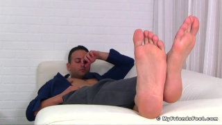 hard-working banker plays with his feet