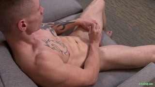 blond cutie Guy Houston strokes his cock